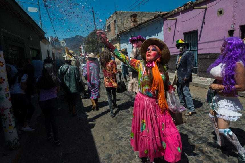 A sayaca throws confetti during the Carnaval parade in Ajijic, Jalisco, Mexico
