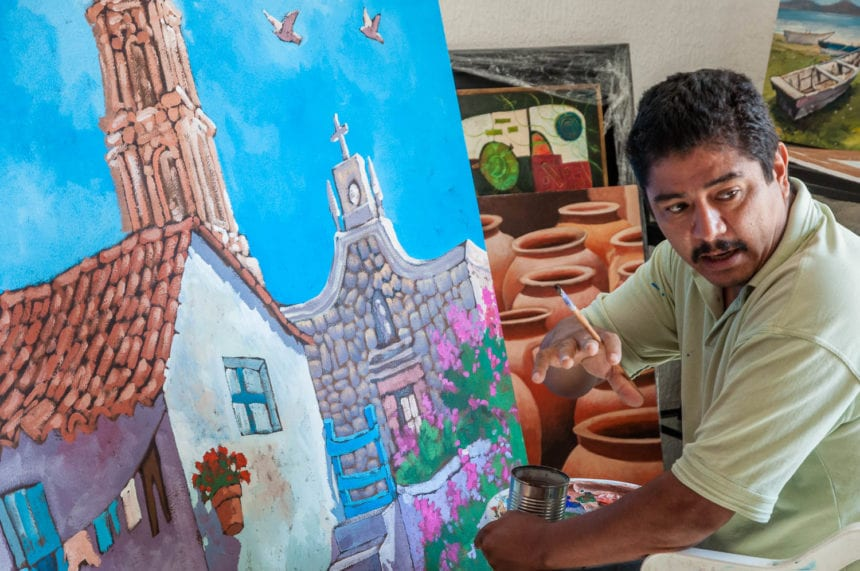 Efrén Gonzalez at work on one of his paintings in 2010.