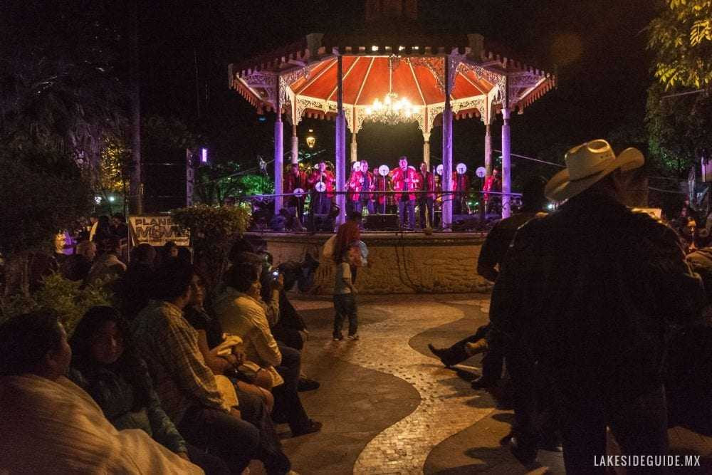 People gather on the plaza around the quiosco to listen to the music. Most nights, a large stage is set up in front of the Centro Cultural Ajijic to accommodate the band and dancing.