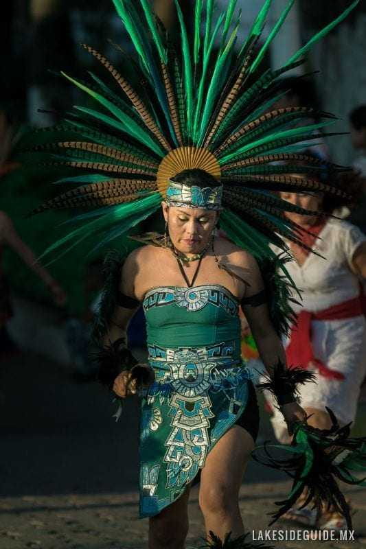 Cristina Aguilar dances in a procession. Aztec dancers who take part in Catholic religious processions are also called concheros.
